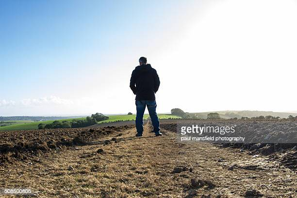 Man standing on country path