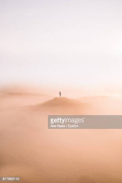 man standing on desert against clear sky - heat haze stock pictures, royalty-free photos & images