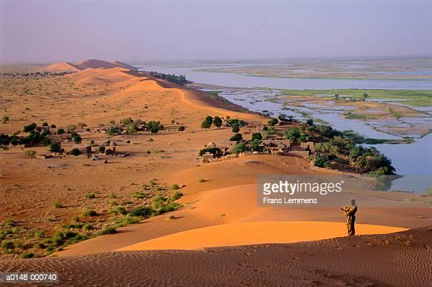 Man Standing on Dune
