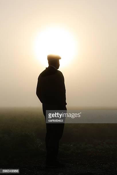man standing on farm