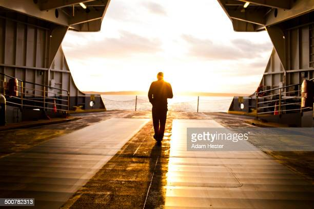 Man standing on ferry deck