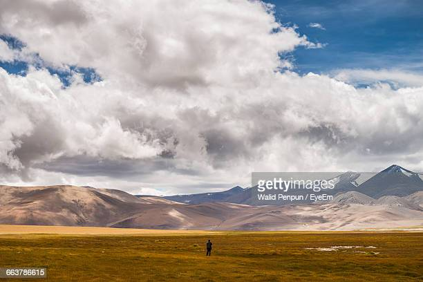 Man Standing On Field Against Cloudy Sky At Ladakh