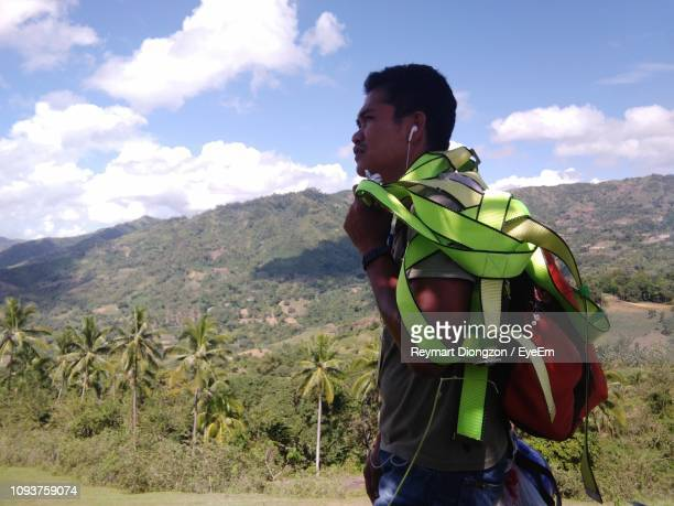 man standing on field against mountains - cebu stock photos and pictures