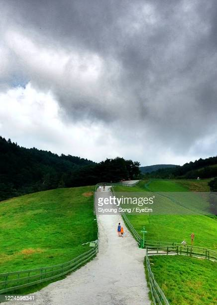 man standing on field against sky - gangwon province stock pictures, royalty-free photos & images