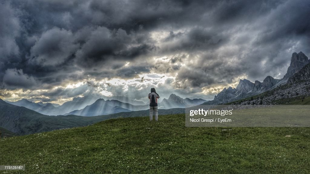 Man Standing On Field Against Sky : Stock Photo