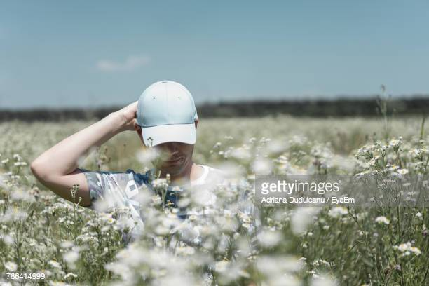 man standing on field amidst plants - adriana duduleanu stock photos and pictures