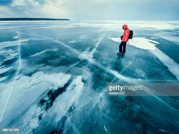 Man standing on frozen lake, Apostle Islands, Wisconsin, America, USA
