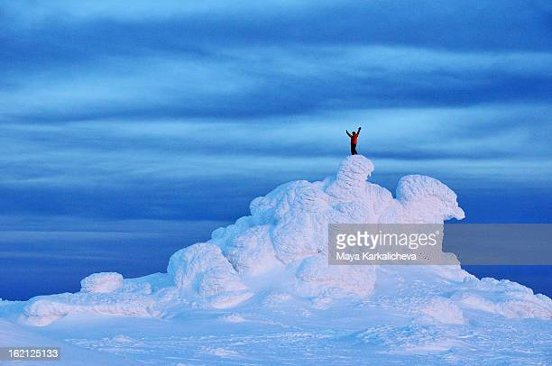 Man standing on frozen rock formations