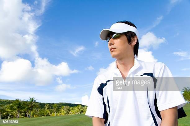 Man standing on golf course, Saipan, USA