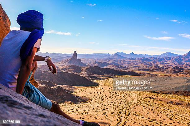 man standing on landscape against blue sky - algeria stock pictures, royalty-free photos & images