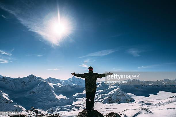 man standing on mount elbrus, russia - summits russia 2015 stock pictures, royalty-free photos & images