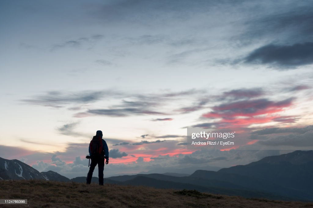 Man Standing On Mountain Against Sky During Sunset : Foto stock