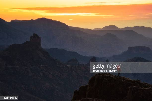 man standing on mountain against sky during sunset - tejeda stock pictures, royalty-free photos & images