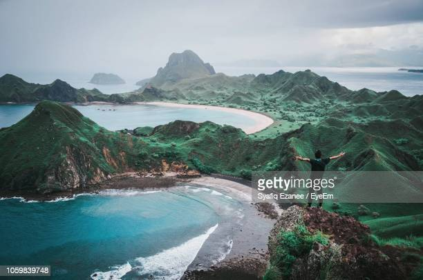 man standing on mountain against sky - east nusa tenggara stock pictures, royalty-free photos & images