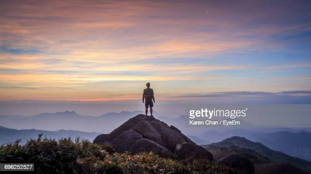 man standing on mountain against sky - on top of stock pictures, royalty-free photos & images