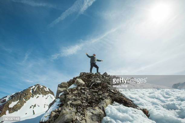 man standing on mountain summit with arms outstretched, chamonix, france - auvergne rhône alpes stock pictures, royalty-free photos & images