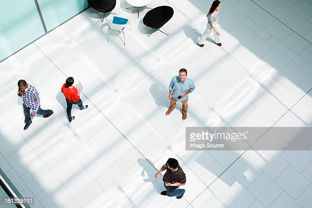 Man standing on office concourse