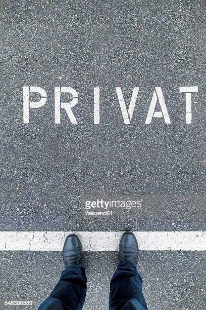 Man standing on private parking area