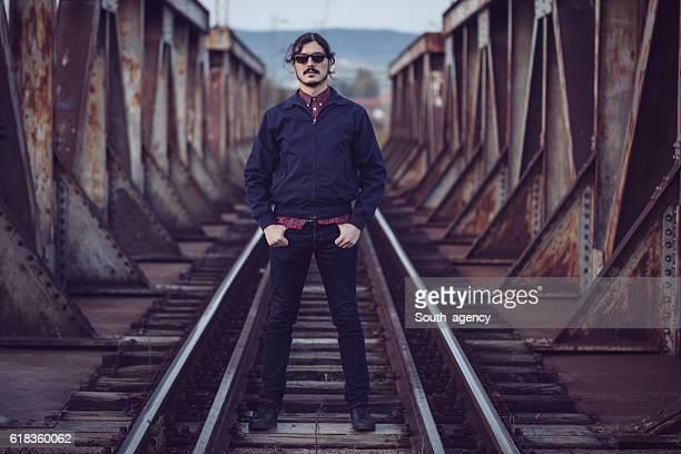 Man standing on railway