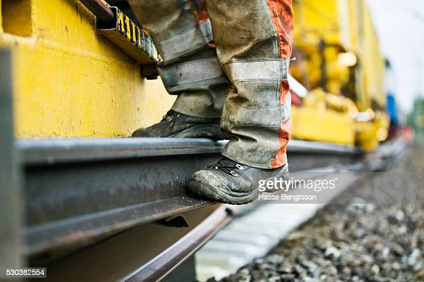 Man standing on railway track