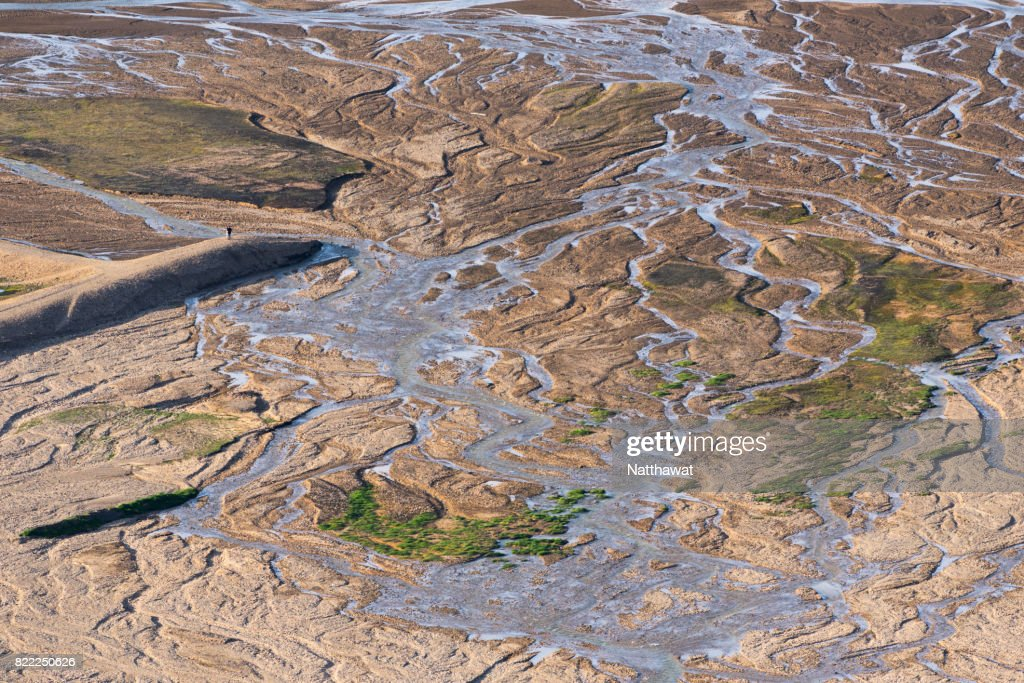 A man standing on riverbed in Landmannalaugar, Iceland : Stock Photo