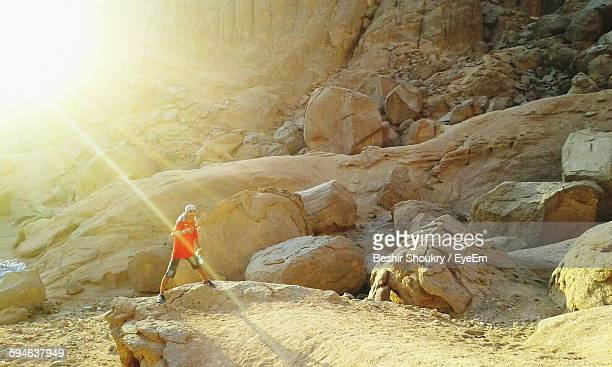 Man Standing On Rock At Desert In Sharm El-Sheikh