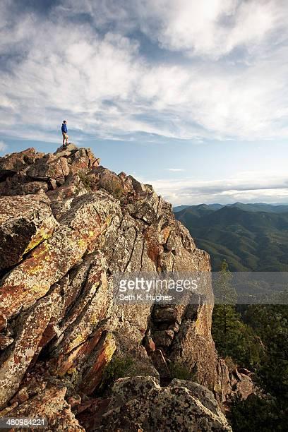 Man standing on rock formation, Boulder, Colorado, USA