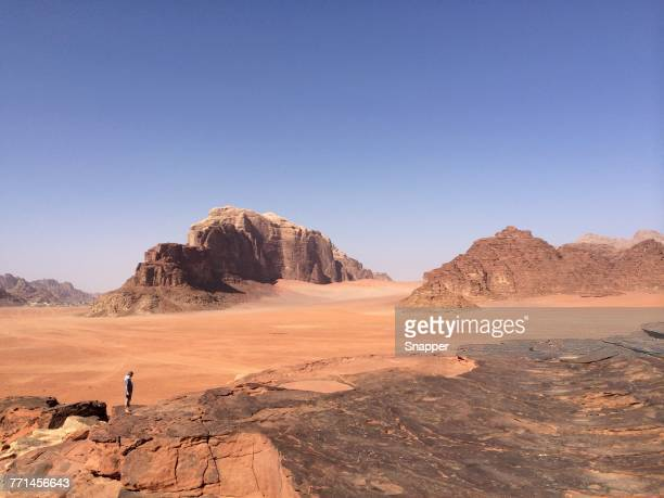 Man standing on rocks, Wadi Rum, Jordan