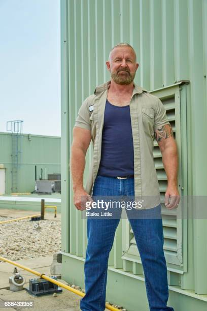man standing on roof - open grave stock photos and pictures