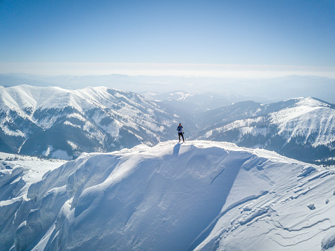 Man Standing On Snowcapped Mountain - gettyimageskorea