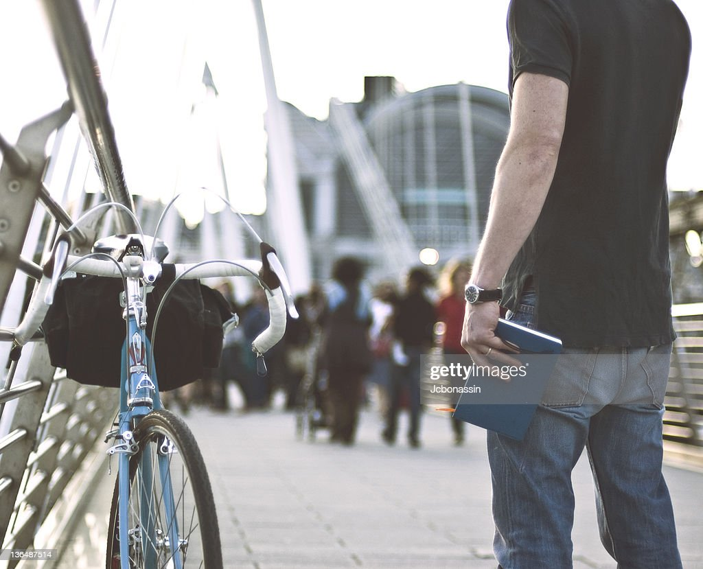 Man standing on street with bicycle,London : Stock Photo