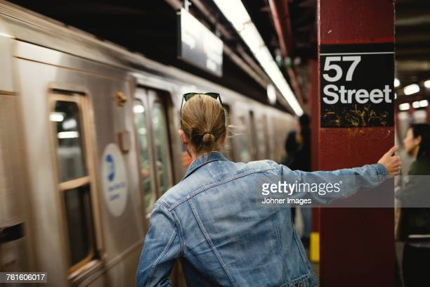 man standing on subway station - new york city subway stock pictures, royalty-free photos & images