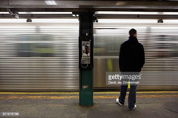Man Standing on Subway Station Platform