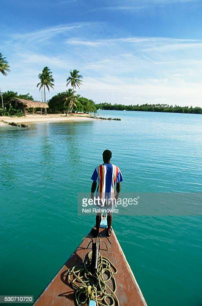 man standing on the bow of a boat - trinidad and tobago stock pictures, royalty-free photos & images