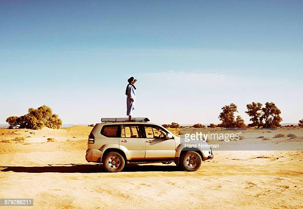 Man standing on the car roof, Morocco