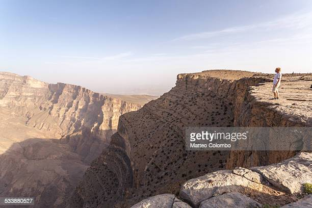 Man standing on the edge of Jebel Akhdar canyon