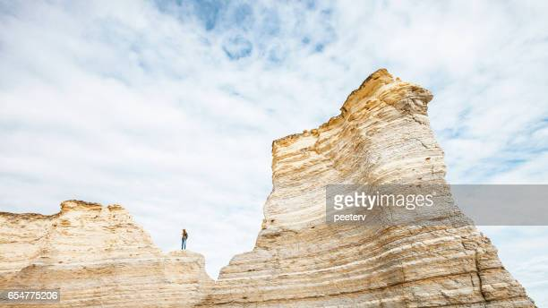 Man standing on the rocks, Kansas.