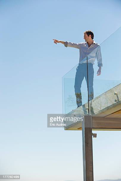 Man standing on the terrace and pointing