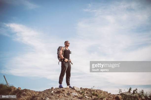 Man standing on the top of a mountain