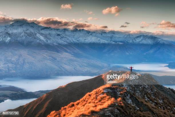 man standing on the top of mount roy - wide angle stock pictures, royalty-free photos & images