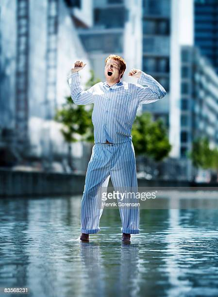 Man standing on the water in pyjamas