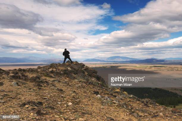 A man standing on top of mountain. A travel and explore concept.