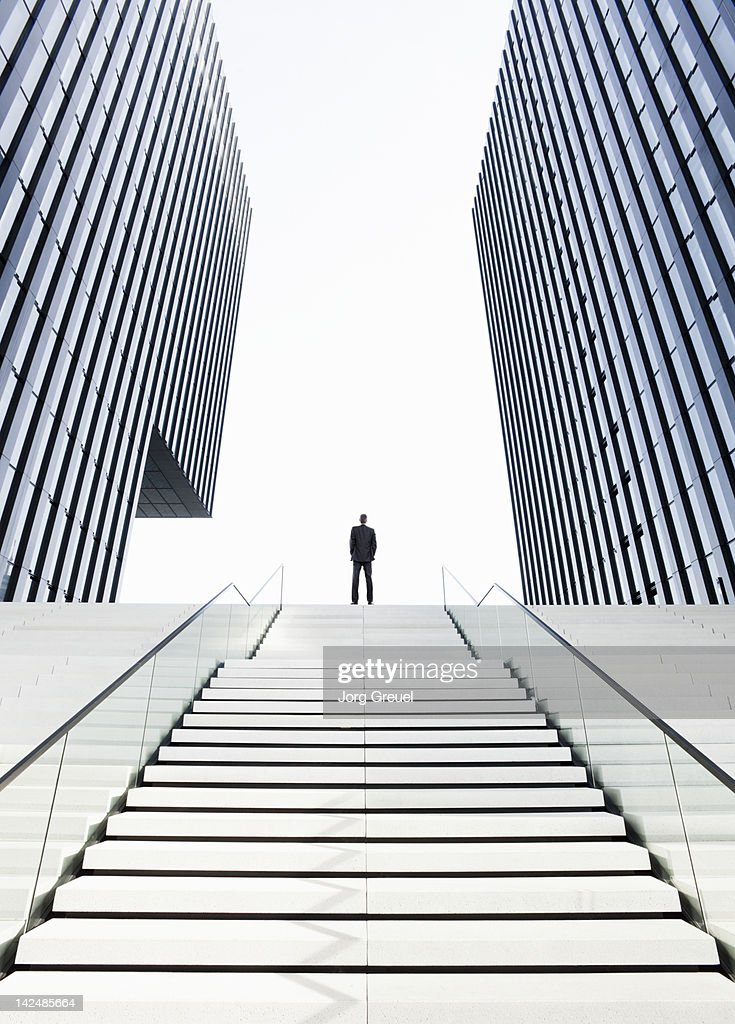 Man standing on top of stairs : Stock Photo