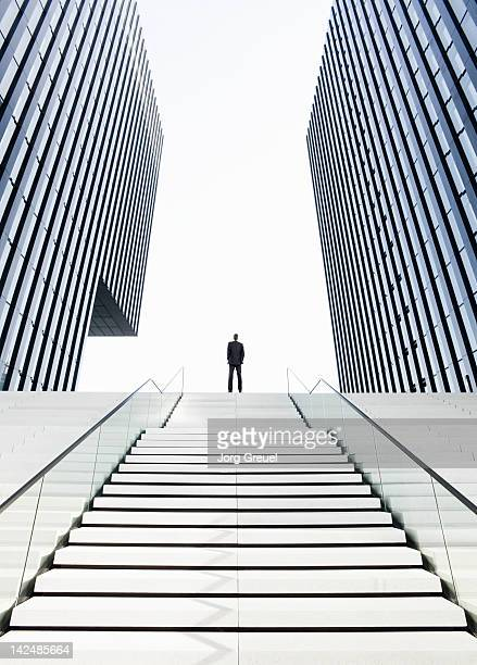 man standing on top of stairs - steps stock photos and pictures