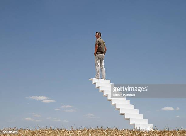 Man standing on top of stairway to sky