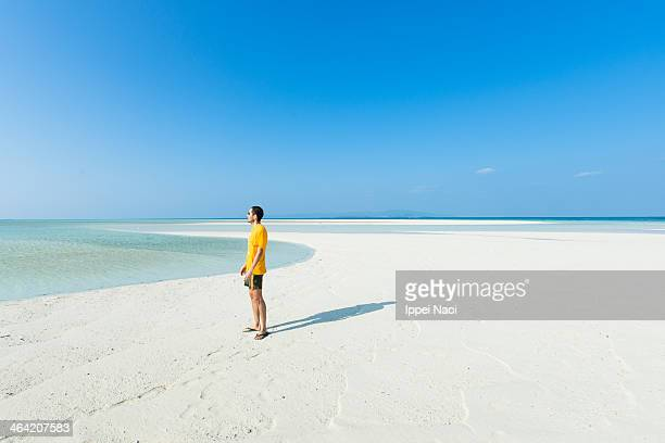 Man standing on tropical paradise beach, Okinawa