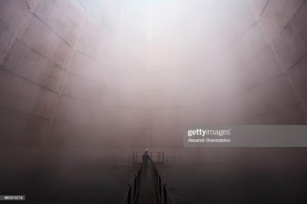 Man standing on walkway in foggy weather : Stock Photo