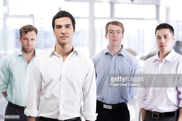 Man standing out from a group of other men
