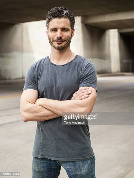 man standing outdoors in the city - mid adult men stock pictures, royalty-free photos & images
