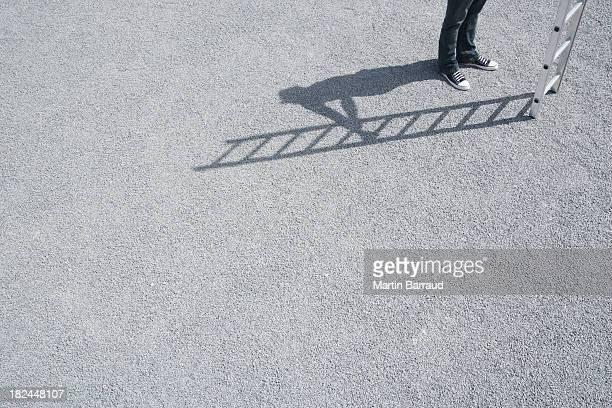 Man standing outdoors near ladder
